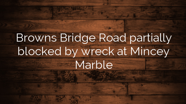 Browns Bridge Road partially blocked by wreck at Mincey Marble